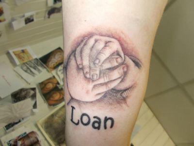 Tatouage portait main d'enfant