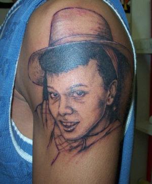 Tatouage portrait sur le bras