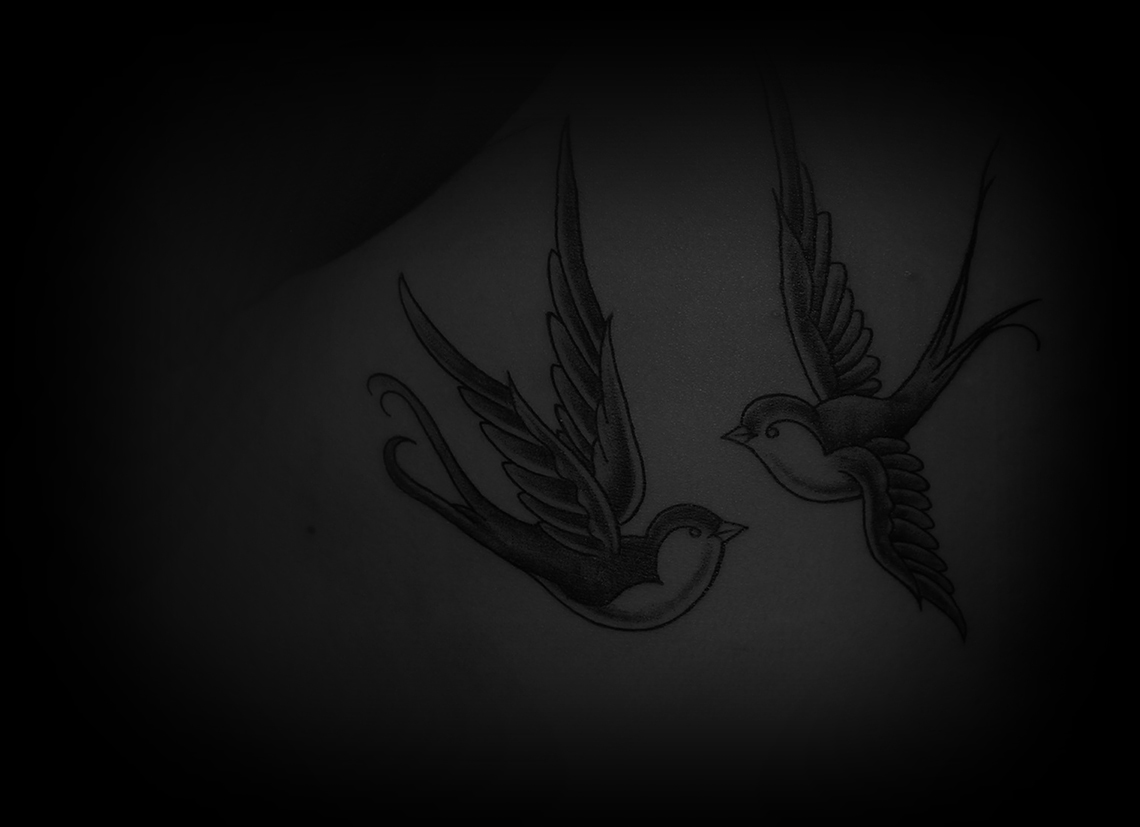 Tatouage old scool hirondelle